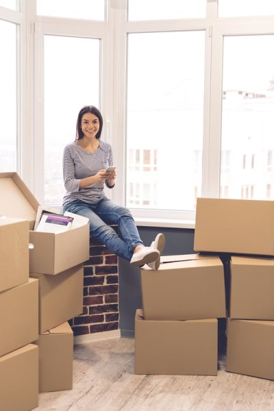 A Girl sitting on the boxes